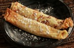 Photo Credit:  Crepes with Cottage Cheese Filling and Powdered sugar.  Copyright 2011, Kim Bauer: All Rights Reserved